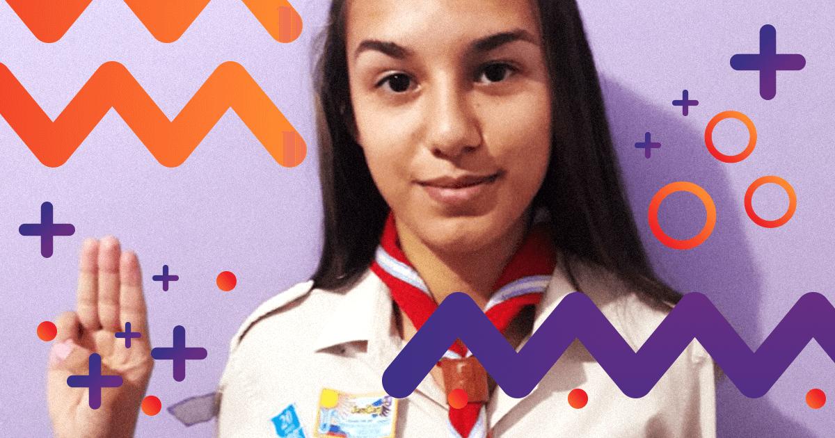 Imagen de una joven scout haciendo la signa de manos que los representa